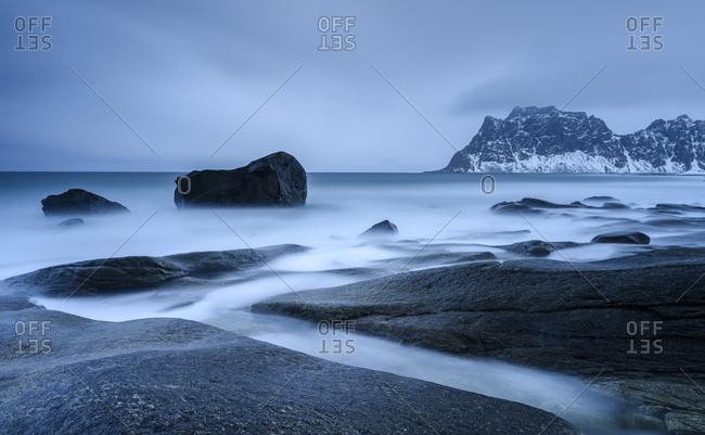 Blue Hour, rocks on the coast in Uttakleiv, Lofoten, Norway, Europe