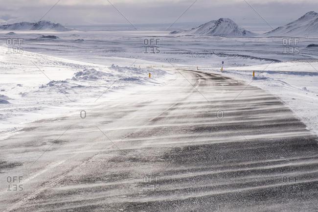 Snow drift over road, Norourland, Northern Iceland, Iceland, Europe