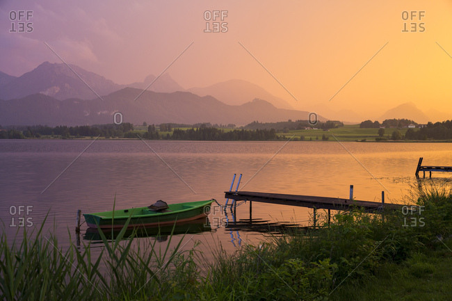 June 11, 2015: Hopfensee in Fussen at dusk, Allgau, Upper Bavaria, Bavaria, Germany, Europe