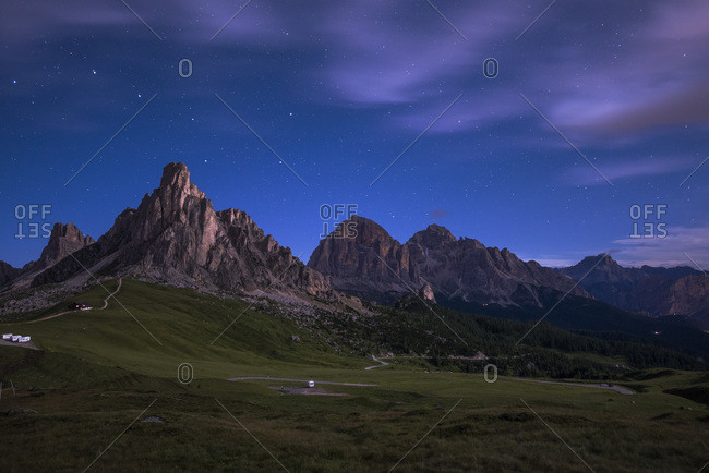 Gusela mountain in a starry night with clouds, Giau Pass, Dolomites, Veneto, Italy, Europe