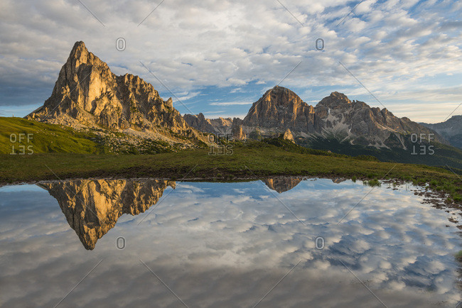 Gusela mountain at sunrise reflected in small lake, Giau Pass, Dolomites, Veneto, Italy, Europe