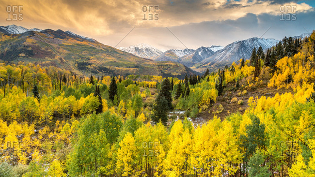 Mountain landscape with autumn forest, snowy peaks of Rocky Mountains, Colorado, USA, North America