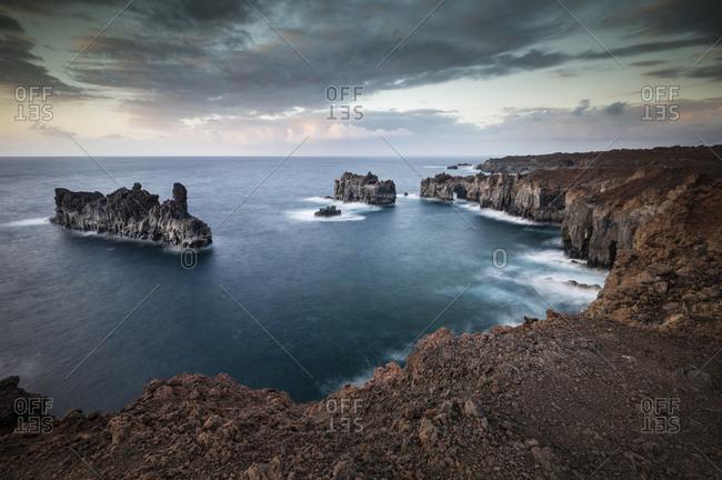 Puntas de Gutierrez, rocky lava coast Punta de la Dehesa, dusk, dramatic sky, El Hierro, Canary Islands, Spain, Europe