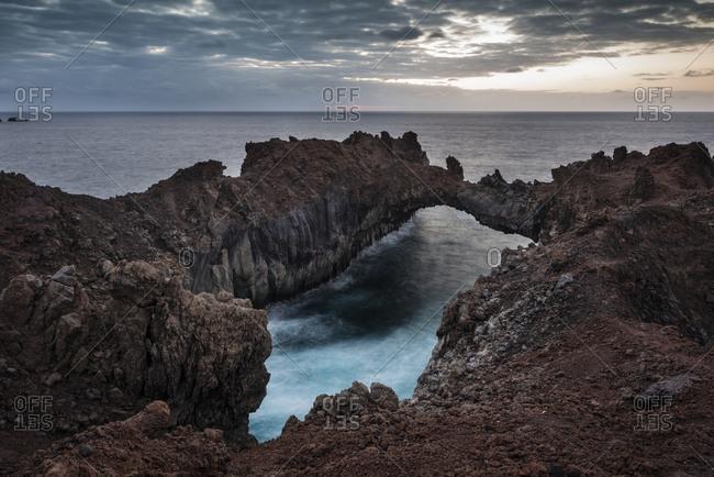 Rock Arco de la Tosca at dusk, rocky lava coast Punta de la Dehesa, El Hierro, Canary Islands, Spain, Europe