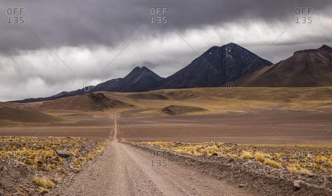 Gravel road through the Andean highlands, behind volcanoes, volcano Chiliques, height 5778m, road B-357, near Socaire, San Pedro de Atacama, El Loa province, Antofagasta region, Norte Grande de Chile, Chile, South America