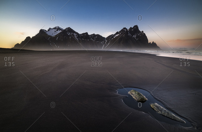 Black lava beach at Cape Stokksnes, sunset, bay Hornvik, Austurland, Island