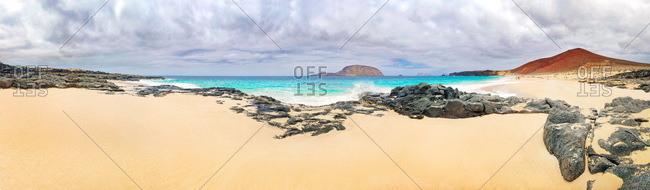 Sandy beach of Playa de las Conchas, volcano Monte Bermeja and island Monta Clara in the background, La Graciosa, Lanzarote, Canary Islands, Spain, Europe