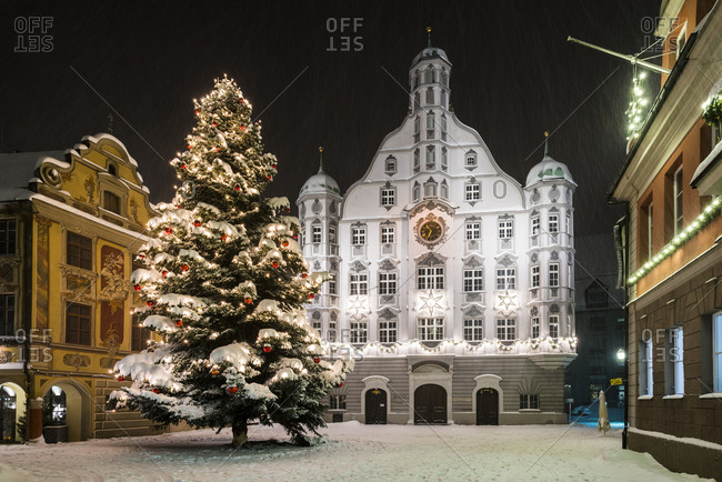 Christmas tree in front of city hall in snow, market square, night scene, Memmingen, Allgau, Bavaria, Germany, Europe