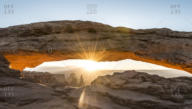 View through Natural Arch, Mesa Arch, Sunrise, Grand View Point Road, Island in the Sky, Canyonlands National Park, Moab, Utah, USA, North America