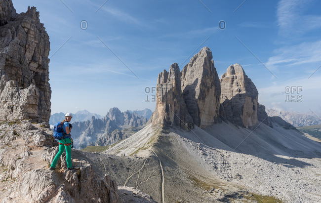 August 31, 2017: Hiker on the via ferrata to Patternkofel, Northern walls of the Three Peaks, Sesto Dolomites, South Tyrol, Trentino-South Tyrol, Alto-Adige, Italy, Europe