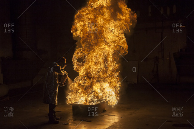 Firefighter extinguishes a heptane 2B-Pan fire with a 2-BTP extinguisher, Illinois, Chicago, USA, North America