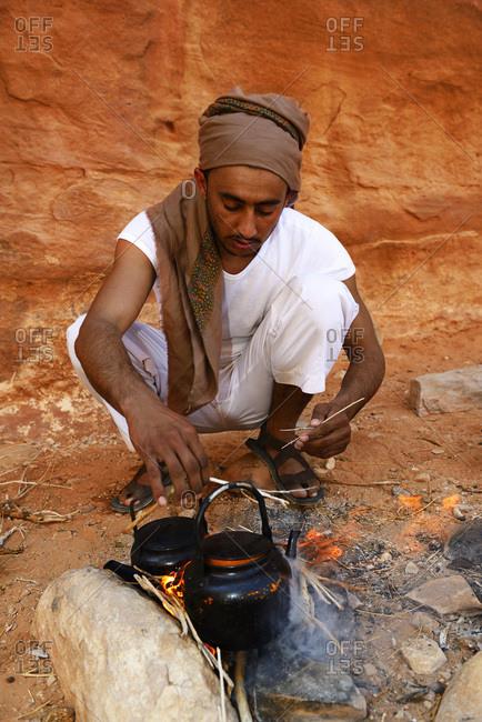 October 21: 2016: Bedouin cooking Tea in camp-fire, Wadi Rum, Jordan, Asia