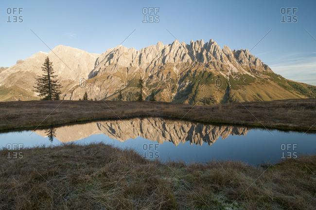 Mandlwande and left Hochkonig in morning light against lake with reflection, Salzburg, Austria, Europe