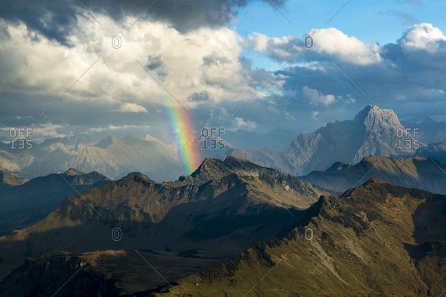 Clouds and rainbow over Allgau Alps, on the right Grosser Widderstein, Vorarlberg, Austria, Europe