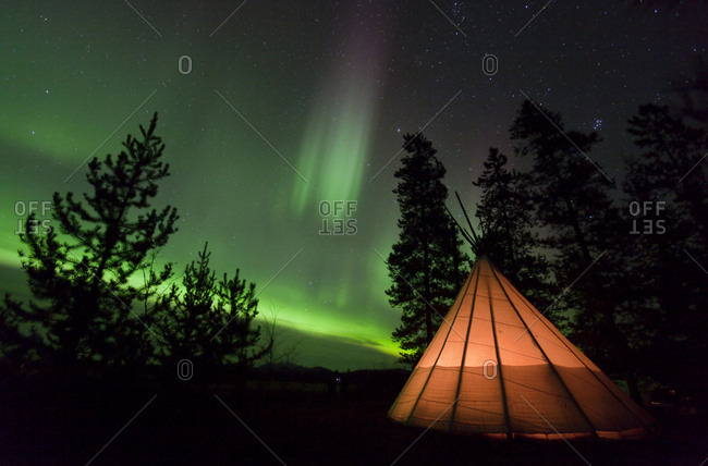 Illuminated, lit teepee, tipi, tepee, Northern polar lights, Aurora Borealis, green, near Whitehorse, Yukon Territory, Canada, North America