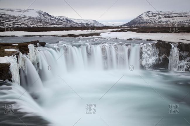 Godafoss waterfall in winter in Fossholl, Southern Region, Island