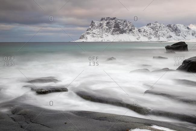 Waves on the beach in winter, Utakleiv, Lofoten, Norway, Europe