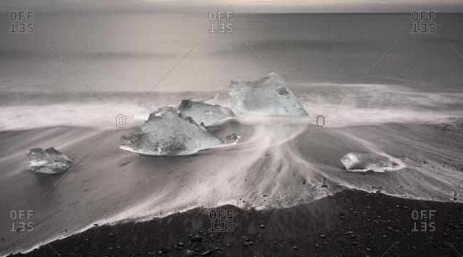 Melted icebergs on the beach of Jokulsarlon, Jokulsarlon, southwest coast, Iceland, Europe