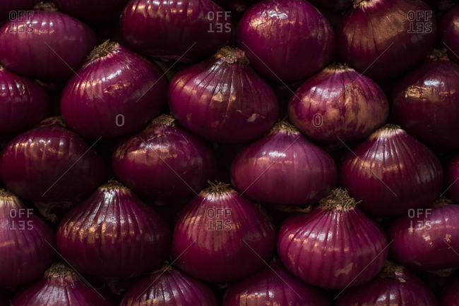Stacks of raw red onions