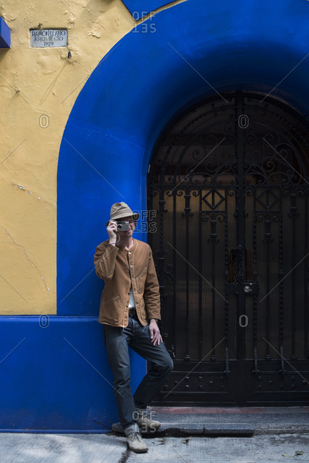 Mexico City - August 30, 2016: Man taking a photograph outside