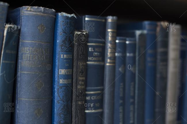 Mexico City - August 30, 2016: Row of old books on shelf at Libreria La Aventura de Leer bookstore