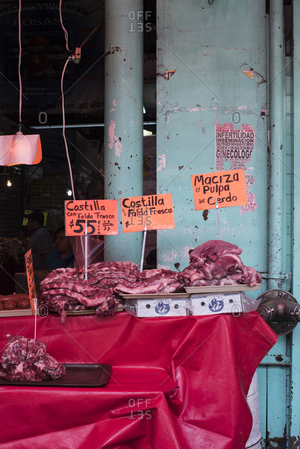 Mexico City - August 29, 2016: Table of red meat at La Merced Market