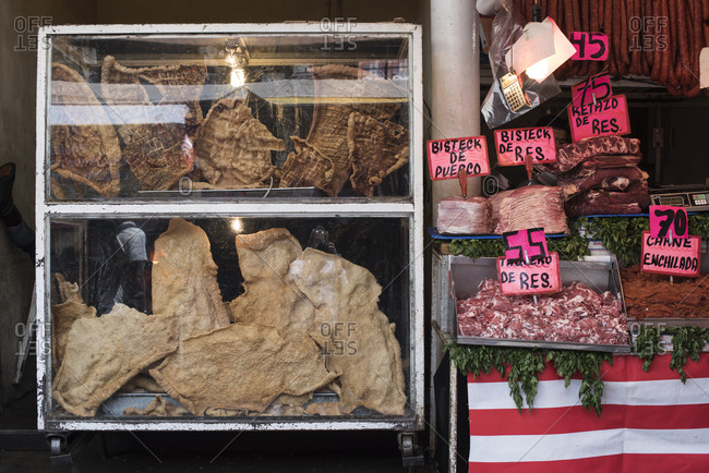 Mexico City - August 29, 2016: Meat and chicharrones at La Merced Market