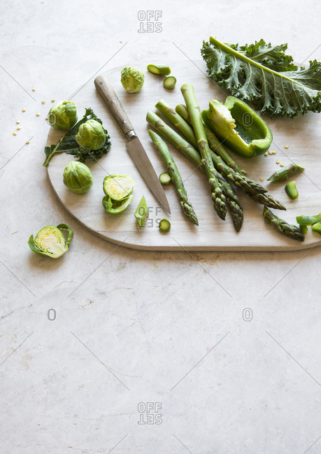Green vegetables on a chopping board