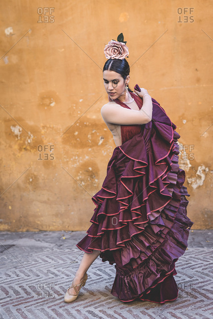 Flamenco dancer with typical costume in the streets of Seville