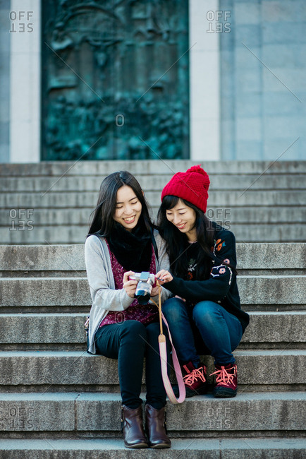 Women with camera on stairs