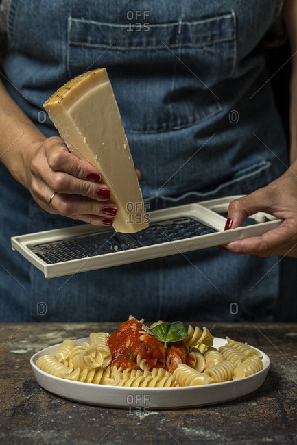 Person scratching cheese
