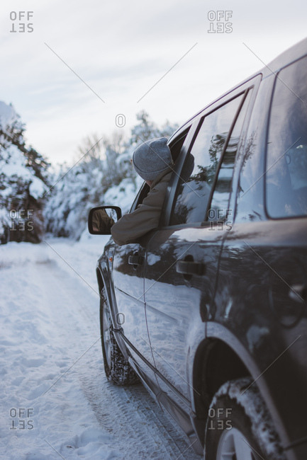 Man in car on winter road