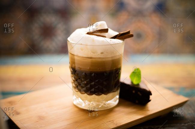 Tasty coffee drink with cinnamon