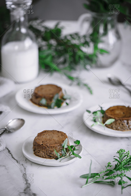 Three plates with delicious chocolate confectionery standing on white marble background