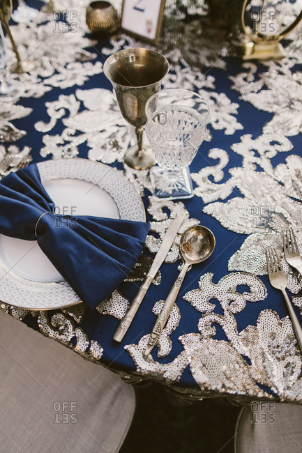 Gold and blue tables at a party