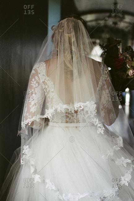 Bride walking down hallway