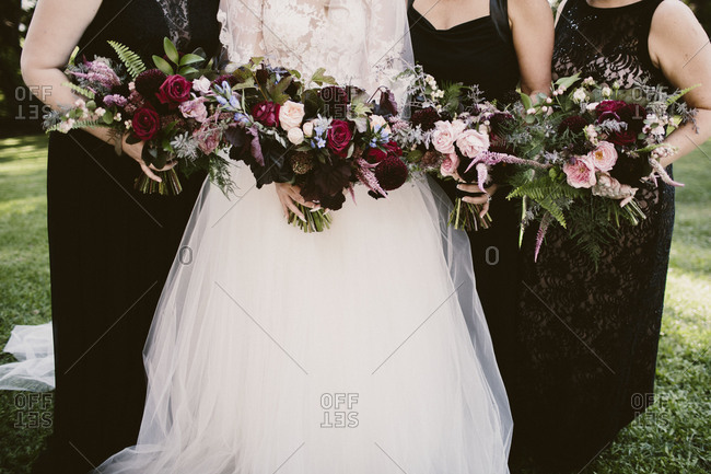 Bride and three bridesmaids holding bouquets