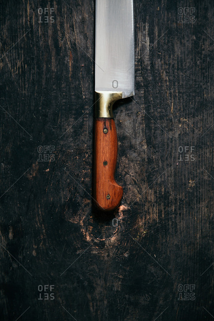 Chef knife on a rustic wooden background