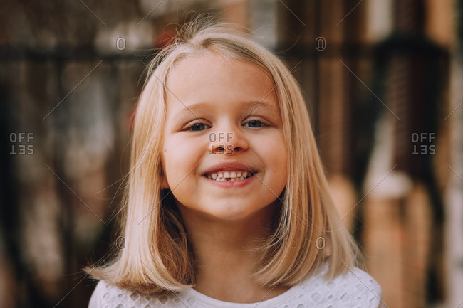 Little girl smiling with missing tooth