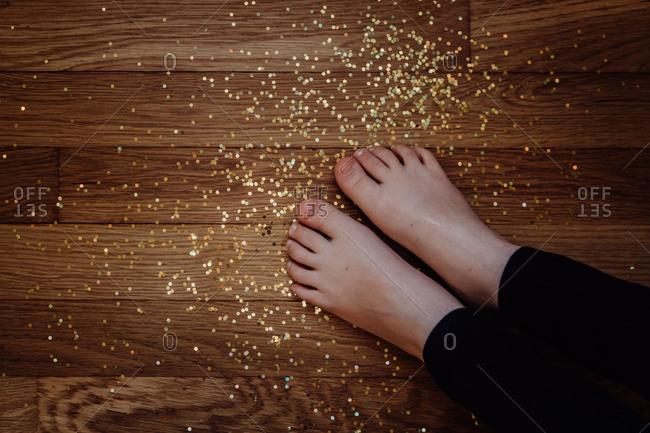 Little feet in spilled glitter