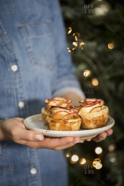 Apple Roses tarts held by a woman