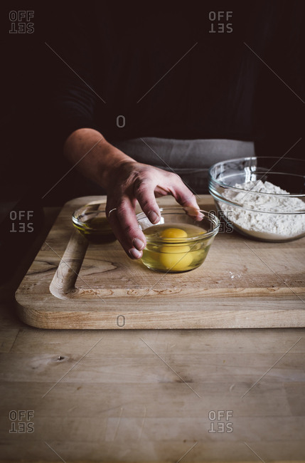Person preparing ingredients to make homemade pasta
