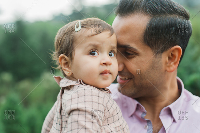 Portrait of a baby girl with her father