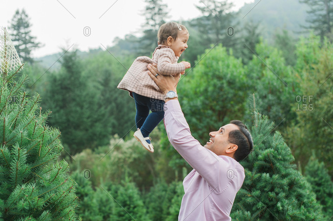 Father lifting up baby daughter