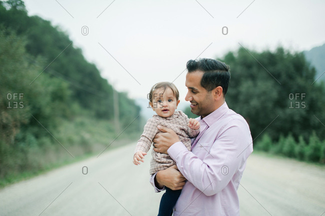Father holding smiling baby girl