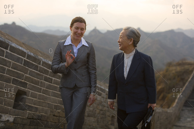 Two businesswomen walking along the Great Wall Of China
