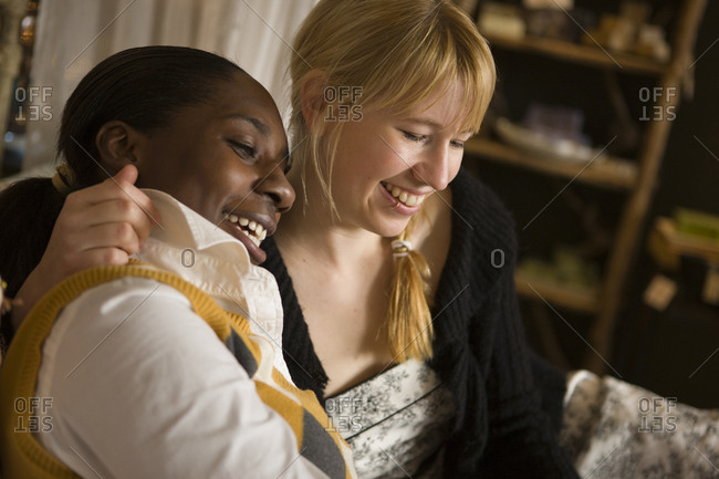 Two smiling women sitting together