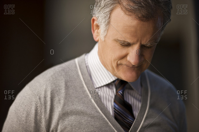 Mature businessman looking downwards