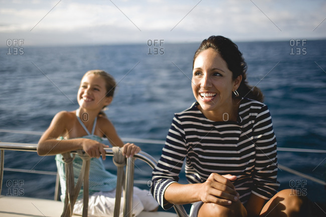 Little girl and woman on boat deck