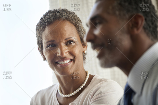 Smiling woman looking at a male colleague